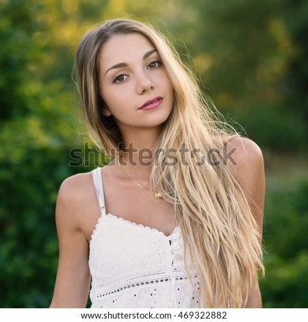 Beautiful Blond Teenager Portrait Outdoors In The Park Filtered Image