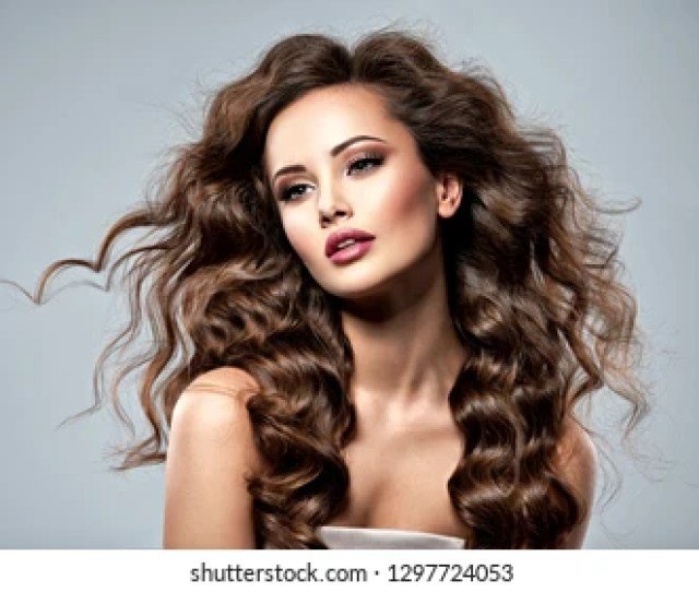 Beautiful Caucasian Woman With Long Brown Curly Hair Portrait Of A Pretty Young Adult Girl