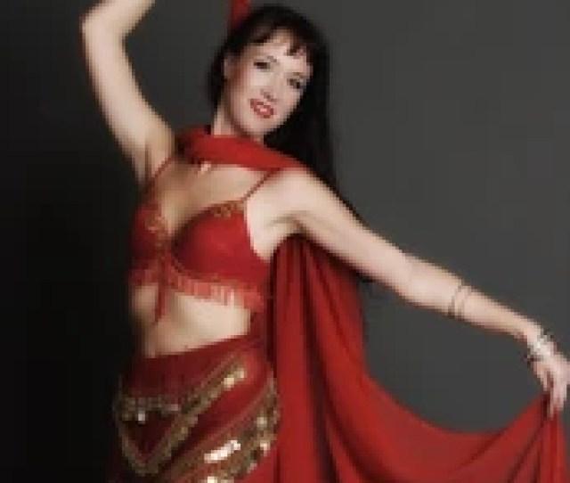 Beautiful Sexy Brunette Dancer In Red In Studio