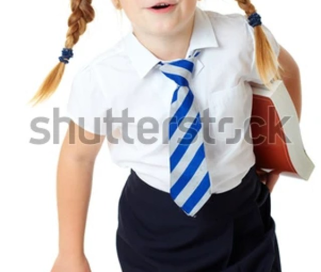 Blonde Schoolgirl Holds Large Book Shoot Over White Background