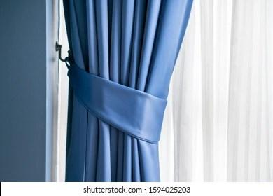 https www shutterstock com image photo blue curtain tie backs 1594025203