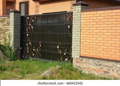 Brick Fence Images, Stock Photos & Vectors