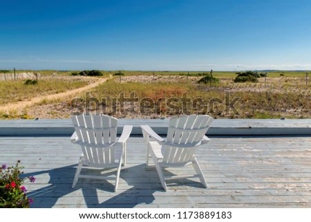 cape cod beach chair harwich grey leather chairs sunset stock photo edit now 1173889183 at with on massachusetts usa