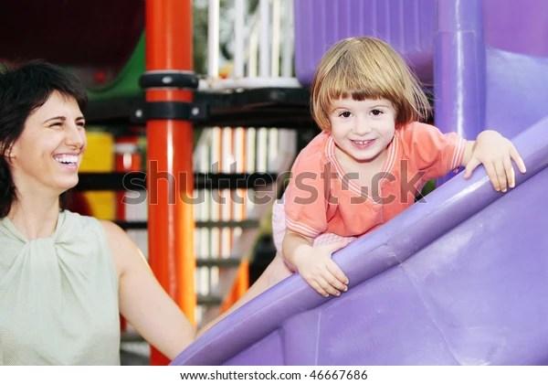 Child Laughing Amusement Park Under Supervision Stock Photo (Edit Now) 46667686