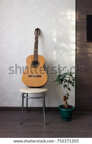 classical guitar chair swing chairs for outdoors lies on next stock photo edit now 750371203 a to ficus near light wall