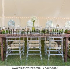 Plastic Chiavari Chair Cover Rentals In Birmingham Al Clear Chairs Paired Rustic Stock Photo Edit Now With Chic Industrial Wood Tables For An Outdoor Wedding Reception