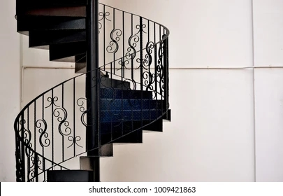 Iron Stairs Images Stock Photos Vectors Shutterstock   Wrought Iron Staircase Designs   Circular Staircase   Stair Grill Design   Railing Grand Staircase   Photo Flower Flower   Stairway