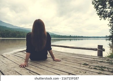 sitting alone images stock