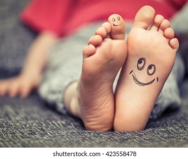 Concept Of Kids Feet With Smiley Face Drawing