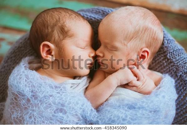 cute newborns lying next