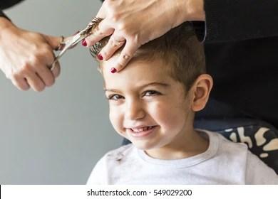 kid haircut images stock