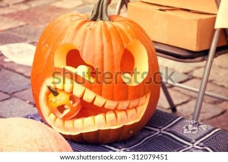 Cuted Halloween Pumpkin Eating Small Pumpkin Stock Photo (Edit Now) 312079451 - Shutterstock