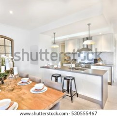 Kitchen Candles Bar Supports Dining Table Set Beside Stock Photo Edit Now Up With The And Hallway To Outside There