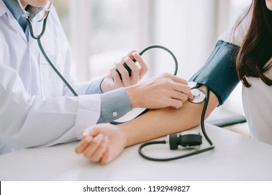 Image result for nurse checking BP