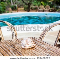 What Are Pool Chairs Made Out Of Amish Child Rocking Chair Elegant Wood Close Swimming Stock Photo Edit Now To A Inside Kenyan Garden