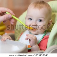 High Chairs For Small Babies Plastic Beach Chaise Lounge Father Feeding Baby Sitting Highchair Stock Photo Edit Now In With Spoon