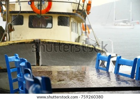 fishing chair rain cover steel without handle boat table chairs seaside under stock photo edit now and at the are