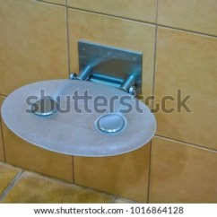 Folding Chair For Bathroom Phil And Teds Poppy High Cover Shower Stock Photo Edit Now 1016864128 In The