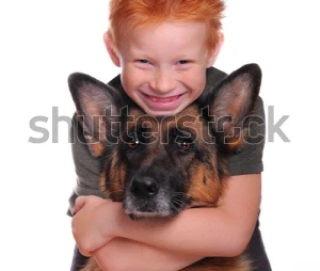 Funny Redhead Boy Hugs Dog German Shepherd Isolated