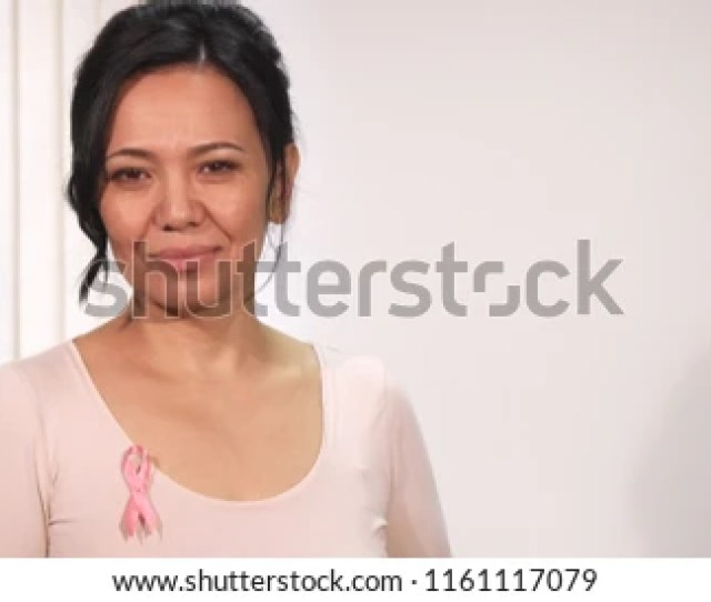 Gorgeous Happy Mature Asian Woman Smiling To The Camera