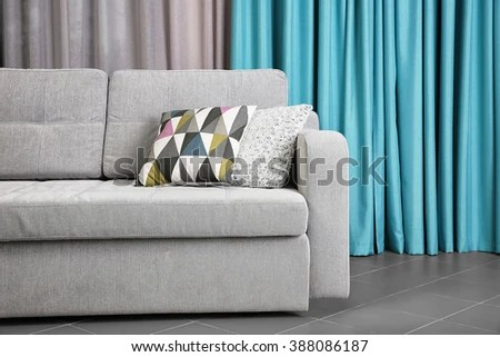 curtains for living room with grey sofa contemporary modern furniture design mentor against blue stock photo edit now in the