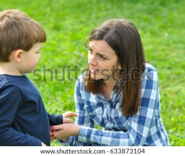 Happy Mom And Son Play In The Park In Spring Mother Talking To Her Son