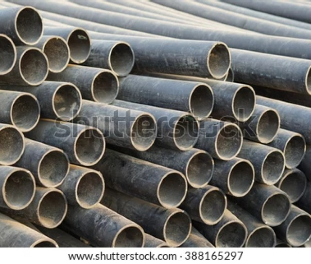 High Density Polyethylene Hdpe Pipe Tube Stack In Nature Evening Sun Light