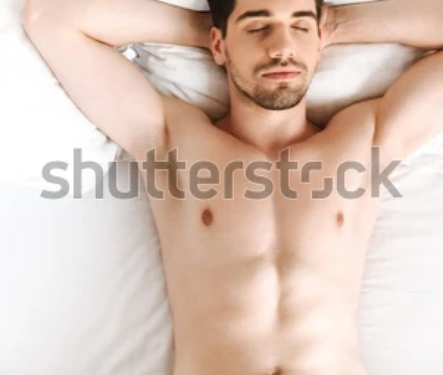 Image Of Young Handsome Naked Man Sleeping In Bed Indoors At Home