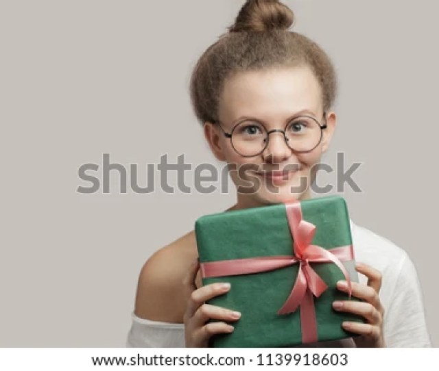 Kind Girl With A Nice Gift For A Child