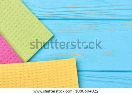 kitchen napkins color paint cabinets on blue wooden background stock photo edit now cellulose rags for washing dish textured woooden table