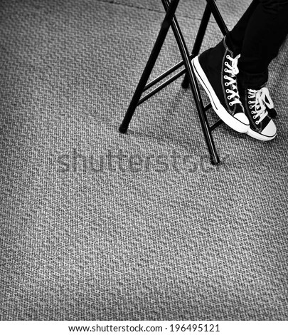 folding chair legs metal bistro table and chairs person running shoes stock photo edit now the of a in on carpet