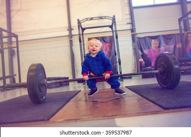 baby lifting weights images