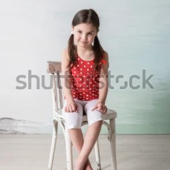 Little Girl Chairs Yellow Fabric Tub Chair Red Sitting On Stock Photo Edit Now 498318283 In The