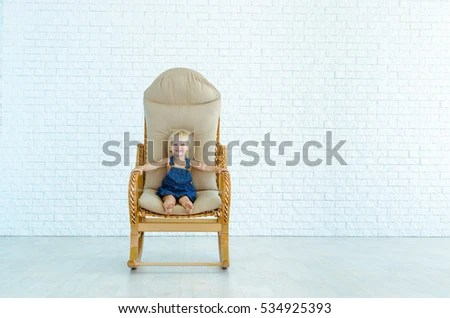 little girl rocking chair stretch covers amazon rides on stock photo edit now 534925393 a the background of white brick wall