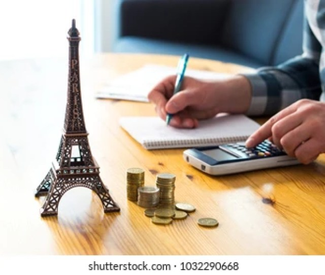 Man Counting Travel Budget Vacation Expenses Or Insurance Cost Traveler Planning Holiday In Europe