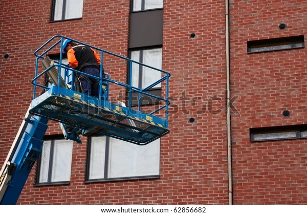 man on lifting platform