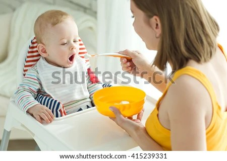 Mother Feeding Baby Boy High Chair Stock Photo (Edit Now) 415239331 - Shutterstock