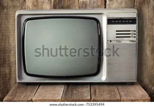 https www shutterstock com image photo old vintage tv on wooden table 753395494