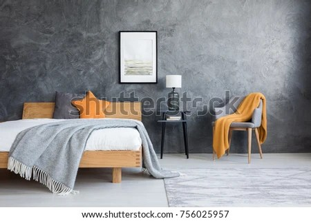 bedroom chair with blanket tablecloths and covers orange on dark stock photo edit now in poster above lamp stool king