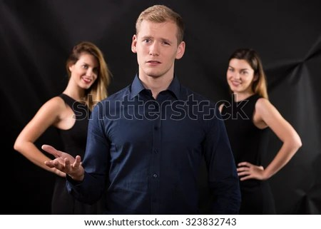 Picture Of Two Women Seducing Handsome Man