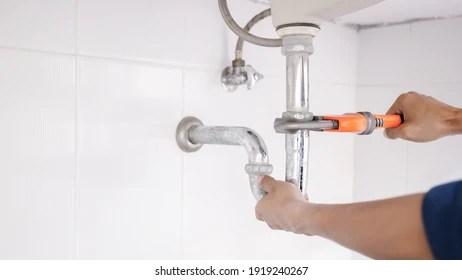 https www shutterstock com image photo plumber working bathroom plumbing repair service 1919240267