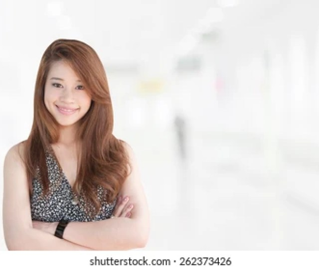 Portrait Of Asia Business Woman   Year Old In Her Office Background Mixed