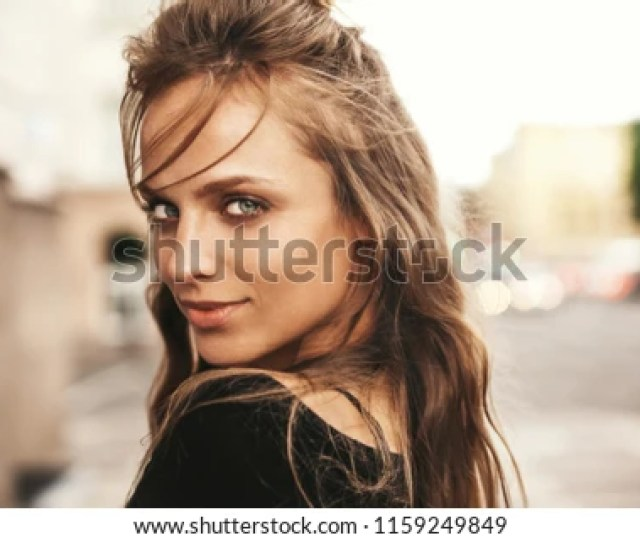 Portrait Of Beautiful Cute Blond Teenager Model Without Makeup In Summer Hipster Clothes Posing On The