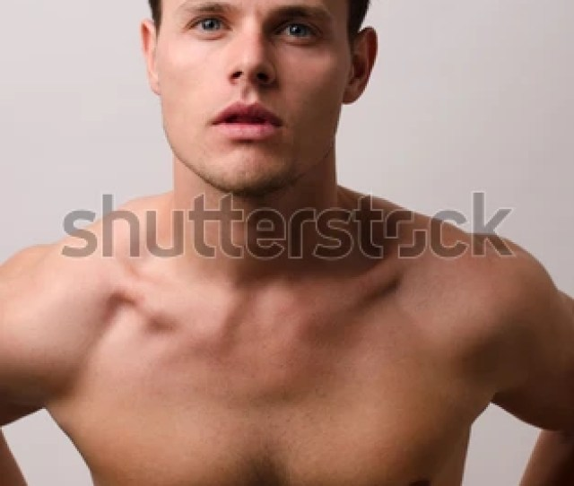 Portrait Of A Beautiful Handsome Naked Man Showing His Pecs Posing Fashion In A Studio