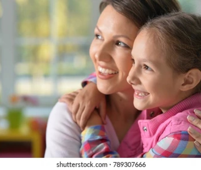 Portrait Of A Charming Little Girl With Mom