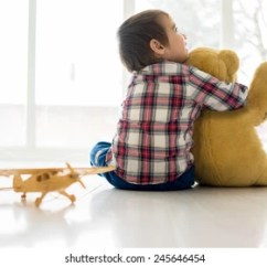 Rocking Chair For Autistic Child Wicker Outdoor Chairs Melbourne Autism Images Stock Photos Vectors Shutterstock Portrait Of Sitting In Living Room With Teddy Bear