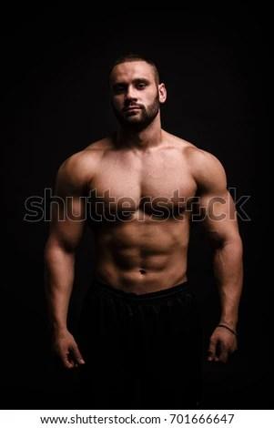 portrait male flexing muscles