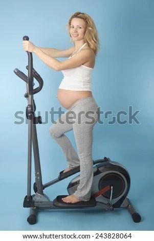 Pregnant Woman On Orbitrek Elliptical Trainer Stock Photo ...