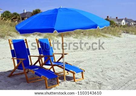 beach chairs and umbrella portable makeup chair pretty blue waiting stock photo edit now for your relaxation at the seashore