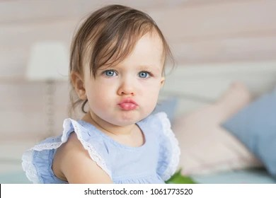 baby pouting images stock